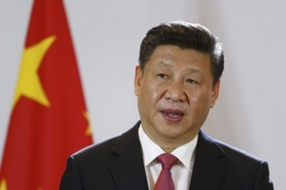 China says will 'never surrender' on trade
