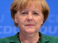 Merkel says euro is too weak due to ECB policy