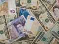 Euro steady on improved economic views